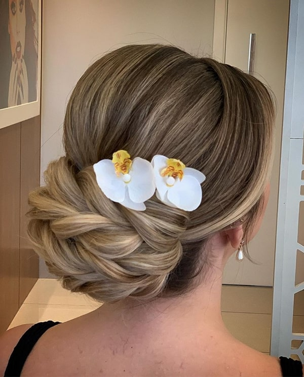 bun party hairstyle with flowers