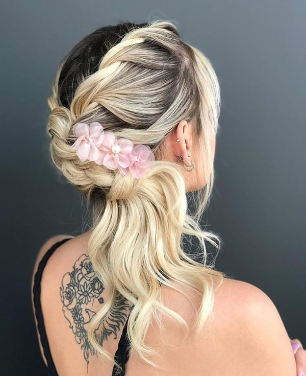 party hairstyle semi fastened with barrette