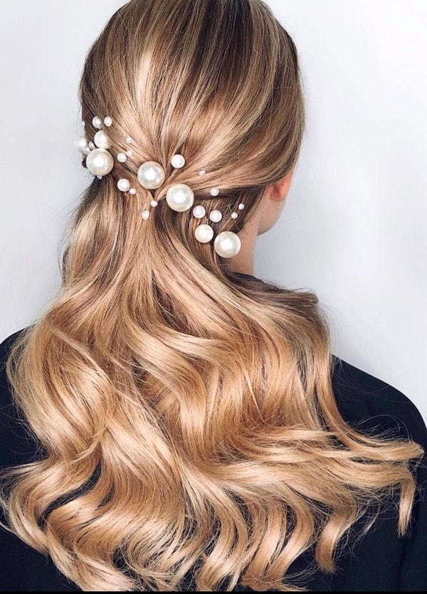 semi hairstyle pinned with pearls