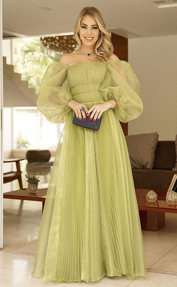long green party dress with puffed sleeve with transparency