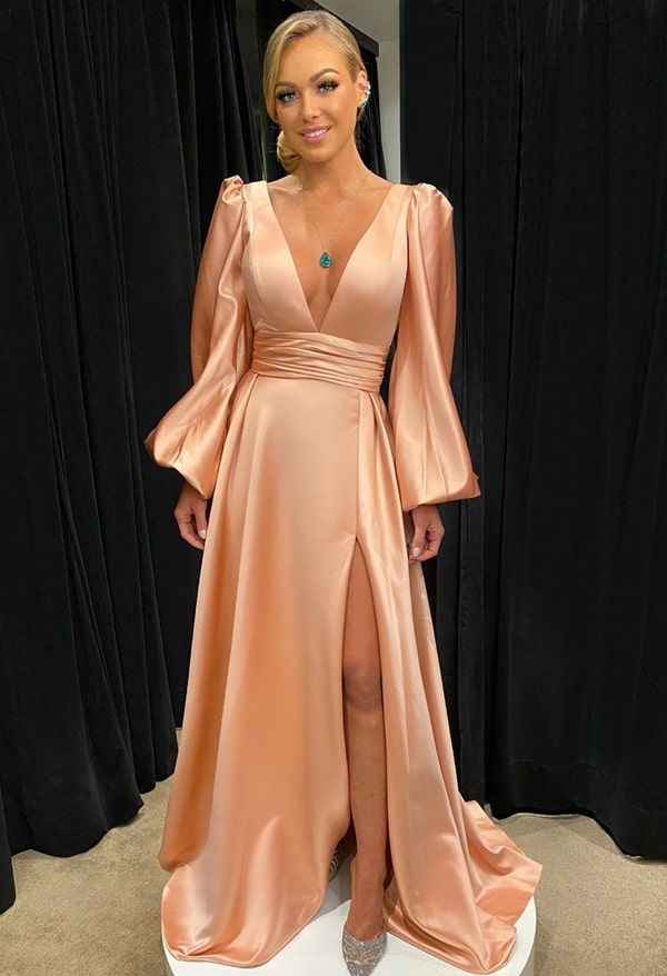 long pink party dress with puffed long sleeve and slit