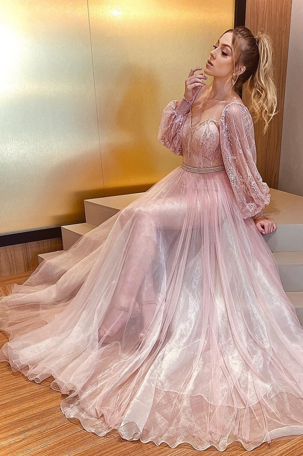 Long pink dress with transparent skirt and puffed lace sleeves