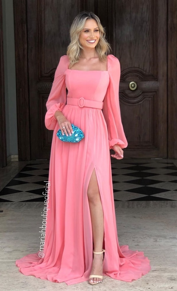 Pink dress with long puffed sleeves, slit and belt made of the same fabric as the dress.