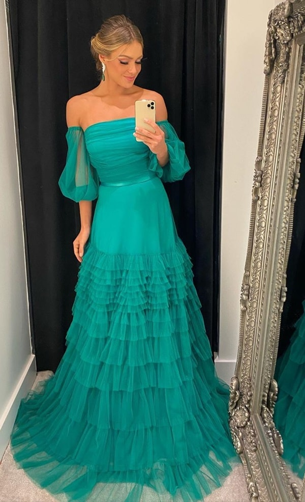 long green party dress with puffed sleeves