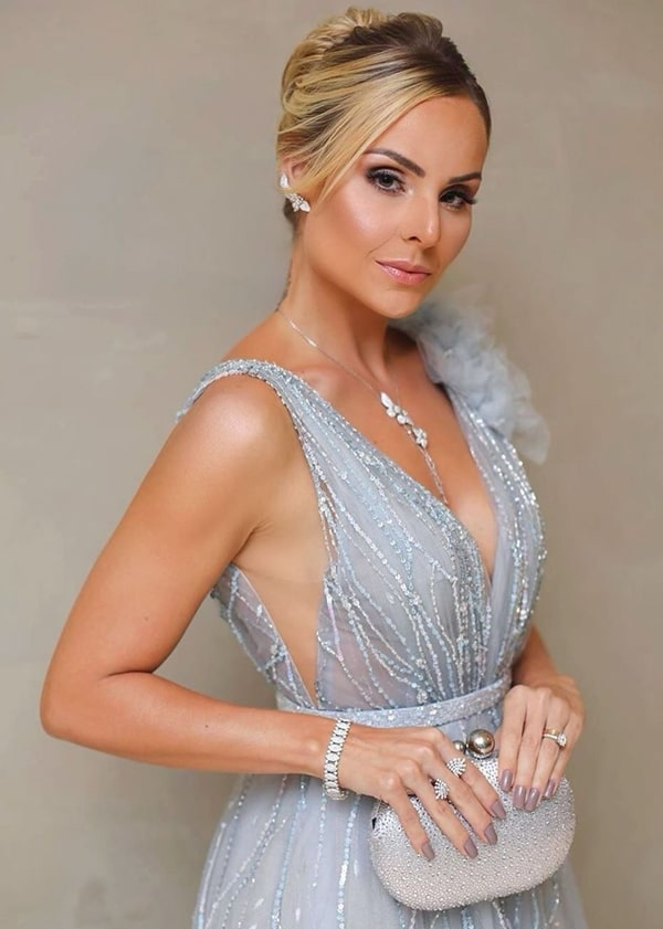 Layla Monteiro silver clutch and jewelry party dress